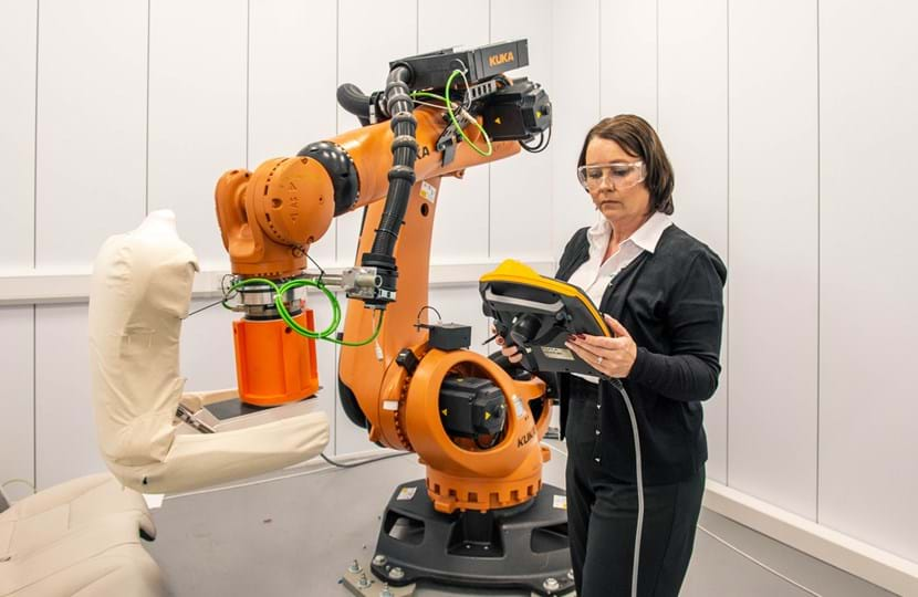 Female Engineer With Seat Testing Robot