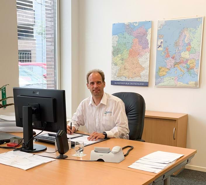 Millbrook employee in office in Germany